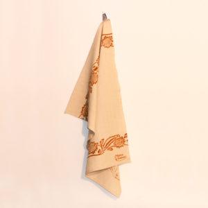 asciugamano-cucina-cotone-girasole-ruggine-appeso